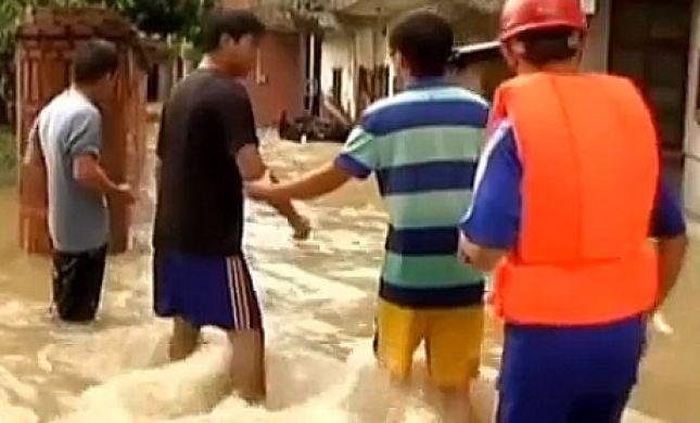 אסון בסין: סופת גשמים קברה עשרות בני אדם
