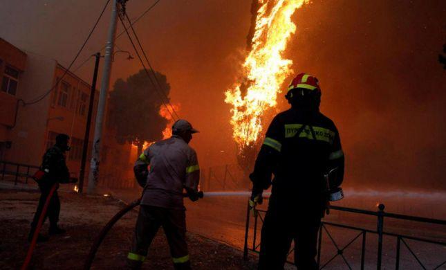 יוון עולה באש: 50 הרוגים בשריפות ענק באתונה