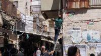 חדשות חרדים כוח משטרה הסיר דגלי פלסטין שנתלו במאה שערים