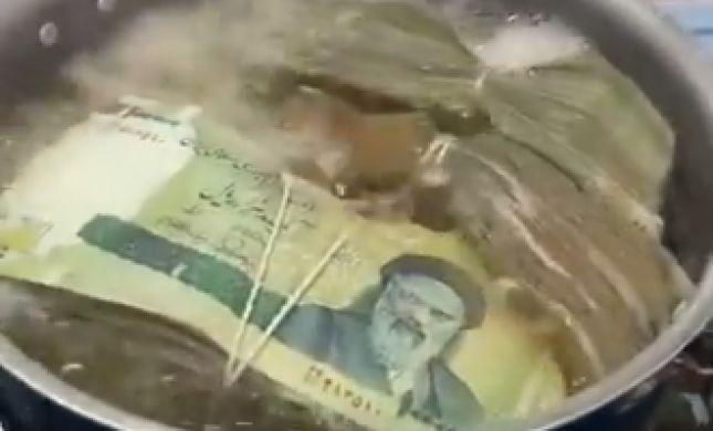 צפו: האיראנים מרתיחים כסף כדי להיפטר מהקורונה