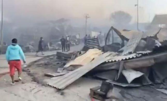 מחנה הפליטים מוריה נשרף: 12,000 איש איבדו קורת גג