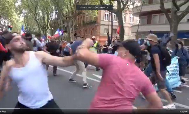 צפו: אלימות בין תומכי ומתנגדי חיסונים בפריז